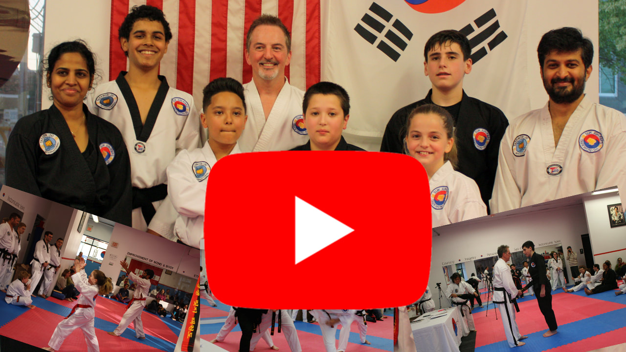 Thumbnail of YouTube video showing play button and newly promoted Black Belts